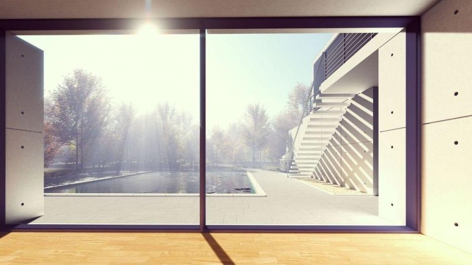 bild på stort treglasfönster ut mot pool